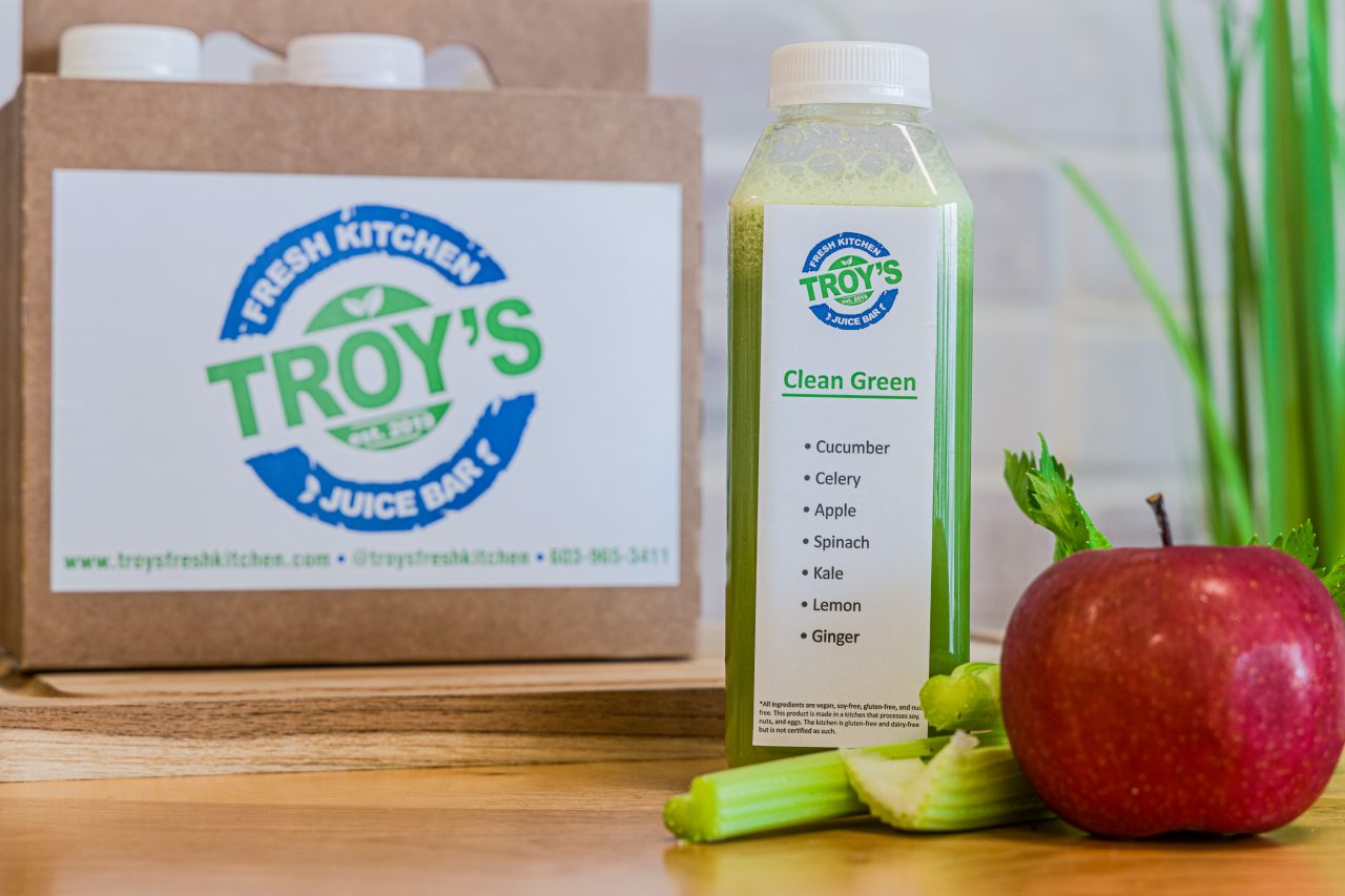 Advance Cleanse 6 pack of juices featuring Clean Green Juice with an apple