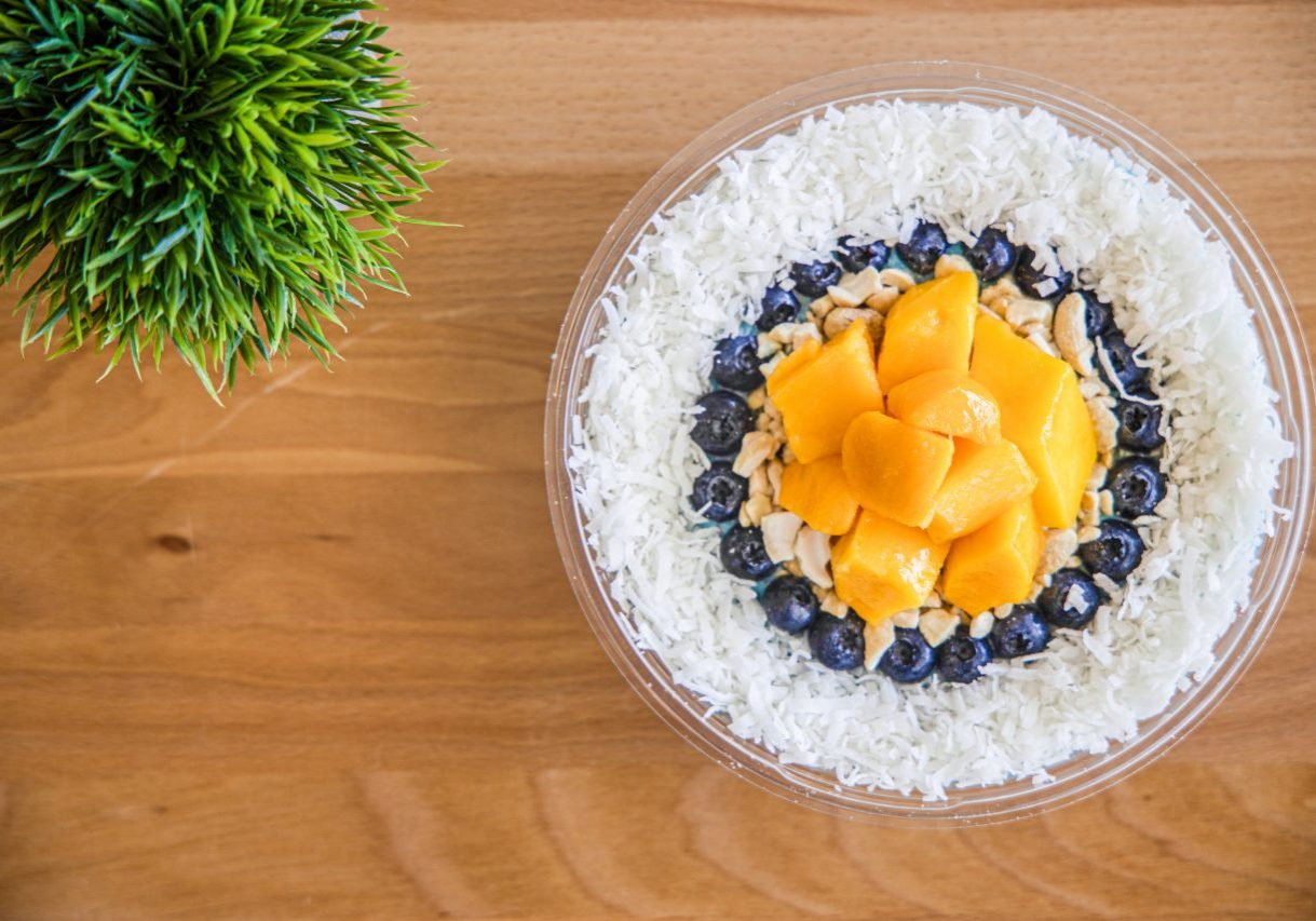 Islander Smoothie Bowl - Coconut milk, pineapple, mango, coconut oil, blue spirulina Toppings: coconut flakes, fresh mango, cashews, blueberries